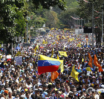 Opposition demonstrators on Feb. 12. Armed pro-government groups attacked and shot at people protesting against Maduro's government late last Tuesday in the Andean city of Merida in western Venezuela, injuring five, activists said.